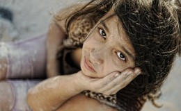 Poverty and poorness on the children face. Sad little girl. Refu